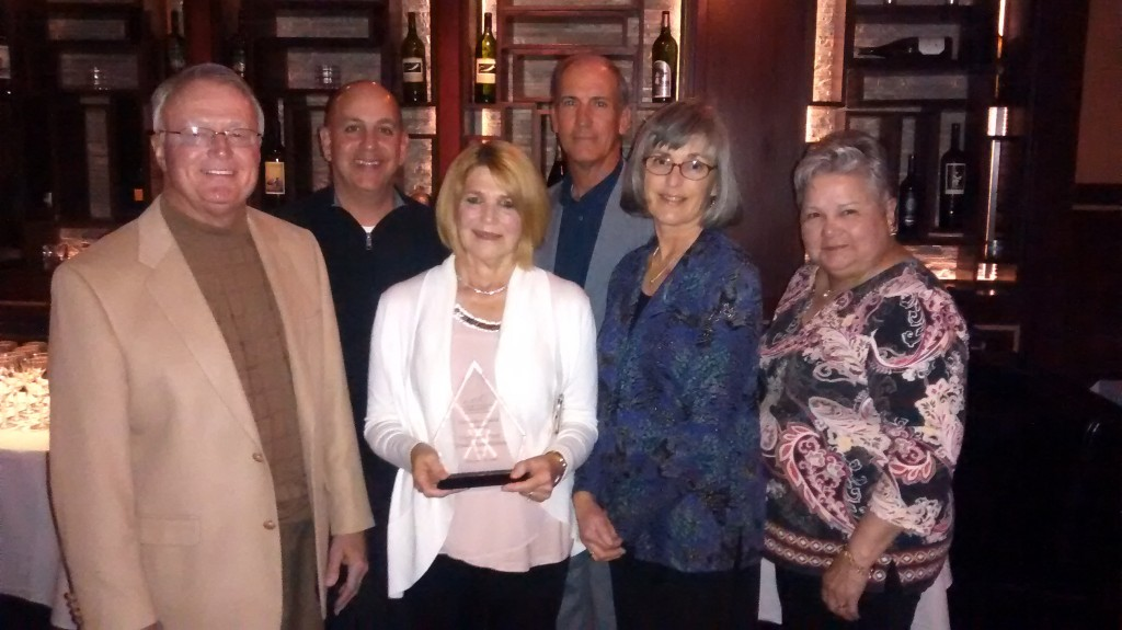 HPTA Honored with CFF Sustainer Award. Pictured, from left, is Jim Crane, Baton Rouge Cystic Fibrosis Board chairman, with HPTA representatives Rusty Jabour, former president; Sandra Harshbarger, president; Gary Mollere, immediate past president, Lisa Sanner, tournament director; and Joycelyn LeBlanc, round robin coordinator.