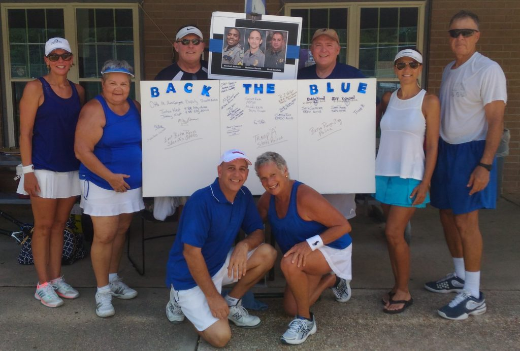 "HPTA players representing the ""Sea of Blue"" event were (front row, l-r) Rusty Jabour and Sybil Rhodes; (standing l-r) Paula Davis, Joycelyn LeBlanc (organizer), Steve Jackson, Haggai Davis, Sheri Goings, and David Oliver."